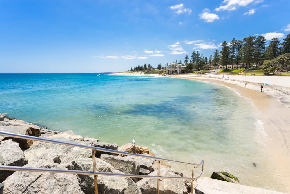 Cottesloe Beach and the Indiana Tea House on a summer day with a clear blue sky. Cottesloe Beach is a popular location for tourists to visit in Perth, Western Australia, Australia. #australia #perth